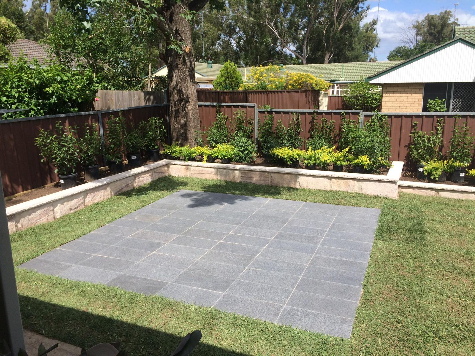 Garden centerpiece with stone paving